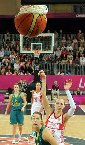 Russian centre Irina Osipova scores a basket during the women's preliminary round group A basketball match of the London 2012 Olympic Games Russia vs. Australia on August 3, 2012 at the basketball arena in London. Australia won 70 to 66.  AFP PHOTO POOL/ MARK RALSTONMARK RALSTON/AFP/GettyImages (MARK RALSTON / AFP/Getty Images)