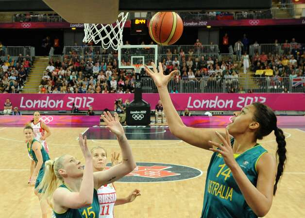 Australian center Elizabeth Cambage scores a basket during the women's preliminary round group A basketball match of the London 2012 Olympic Games Russia vs. Australia on August 3, 2012 at the basketball arena in London. Australia won 70 to 66.  AFP PHOTO POOL/ MARK RALSTONMARK RALSTON/AFP/GettyImages (MARK RALSTON / AFP/Getty Images)