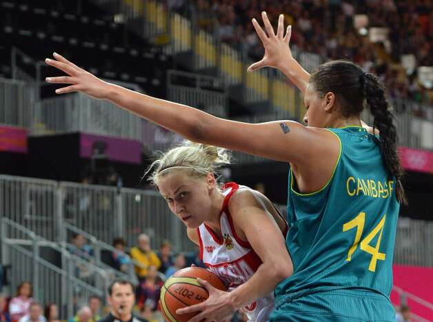 Russian centre Nadezhda Grishaeva (L) vies with Australian center Elizabeth Cambage during the women's preliminary round group A basketball match of the London 2012 Olympic Games Russia vs. Australia on August 3, 2012 at the basketball arena in London. Australia won 70 to 66.  AFP PHOTO MARK RALSTONMARK RALSTON/AFP/GettyImages (MARK RALSTON / AFP/Getty Images)