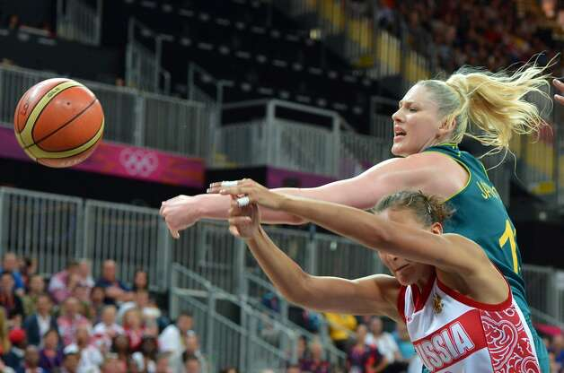 Russian guard Alena Danilochkina (L) vies with  Australian guard Kristi Harrower (R) during the women's preliminary round group A basketball match of the London 2012 Olympic Games Russia vs. Australia on August 3, 2012 at the basketball arena in London. Australia won 70 to 66.  AFP PHOTO MARK RALSTONMARK RALSTON/AFP/GettyImages (MARK RALSTON / AFP/Getty Images)