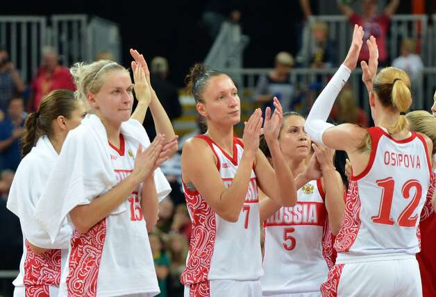 Russian players react at the end of the women's preliminary round group A basketball match of the London 2012 Olympic Games Russia vs. Australia on August 3, 2012 at the basketball arena in London. Australia won 70 to 66.  AFP PHOTO MARK RALSTONMARK RALSTON/AFP/GettyImages (AFP/Getty Images)