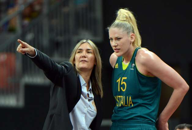 Australian coach Carrie Graf (L) gives instruction to Australian centre Lauren Jackson during the women's preliminary round group A basketball match of the London 2012 Olympic Games Russia vs. Australia on August 3, 2012 at the basketball arena in London. Australia won 70 to 66.  AFP PHOTO MARK RALSTONMARK RALSTON/AFP/GettyImages (AFP/Getty Images)