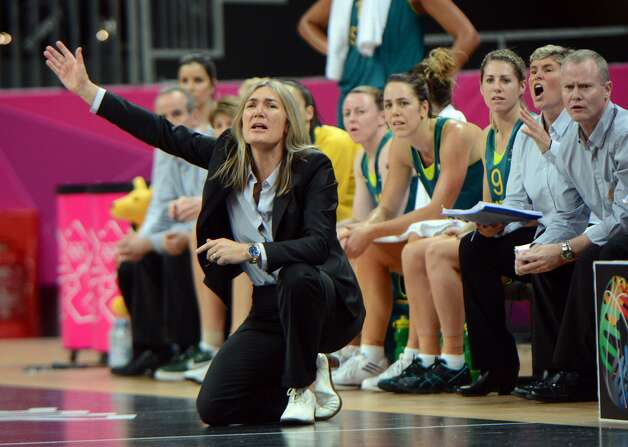 Australian coach Carrie Graf shouts instructions to his players during the women's preliminary round group A basketball match of the London 2012 Olympic Games Russia vs. Australia on August 3, 2012 at the basketball arena in London.  AFP PHOTO / MARK RALSTONMARK RALSTON/AFP/GettyImages (AFP/Getty Images)