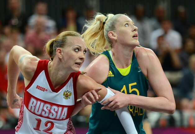 Australian centre Lauren Jackson (R) vies with Russian centre Irina Osipova during the women's preliminary round group A basketball match of the London 2012 Olympic Games Russia vs. Australia on August 3, 2012 at the basketball arena in London AFP PHOTO / TIMOTHY A. CLARYTIMOTHY A. CLARY/AFP/GettyImages (AFP/Getty Images)