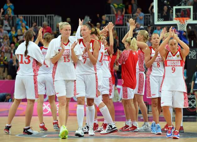 Russian team reacts at the end of the women's preliminary round group A basketball match of the London 2012 Olympic Games Russia vs. Australia on August 3, 2012 at the basketball arena in London. Australia won 70 to 66.  AFP PHOTO / MARK RALSTONMARK RALSTON/AFP/GettyImages (AFP/Getty Images)