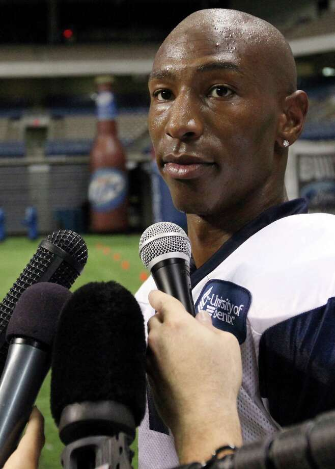 Dallas Cowboys' Sam Hurd answers questions from the media after morning practice at Cowboys Training Camp Sunday July 25, 2010 at the Alamodome. (PHOTO BY EDWARD A. ORNELAS/eaornelas@express-news.net) Photo: EDWARD A. ORNELAS, SAN ANTONIO EXPRESS-NEWS / eaornelas@express-news.net
