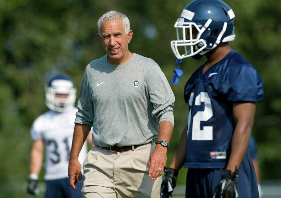 Connecticut coach Paul Pasqualoni watches players at NCAA college football practice in Storrs, Conn., Friday, Aug. 3, 2012. Connecticut's quarterback job is apparently sophomore transfer Chandler Whitmer's to lose as the Huskies begin fall practice on Friday. (AP Photo/Jessica Hill) Photo: Jessica Hill, Associated Press / FR125654 AP