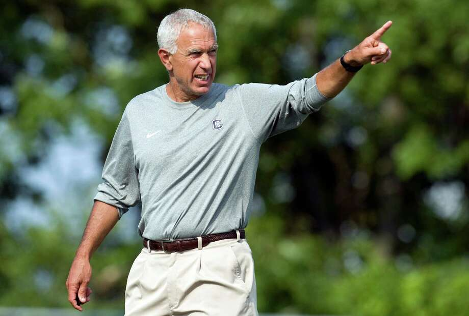 Connecticut coach Paul Pasqualoni calls to players during NCAA college football practice in Storrs, Conn., Friday, Aug. 3, 2012. Connecticut's quarterback job is apparently sophomore transfer Chandler Whitmer's to lose as the Huskies begin fall practice on Friday. Last year's starter, senior Johnny McEntee will be in a group of four others trying to win the job away from Whitmer. (AP Photo/Jessica Hill) Photo: Jessica Hill, Associated Press / FR125654 AP
