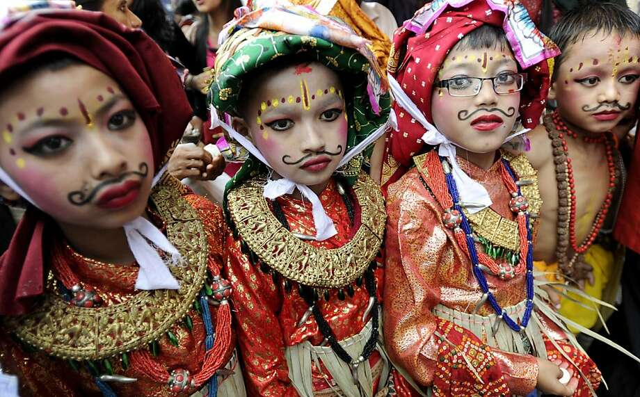 Nepalese children, dressed in traditional cow costumes, take part in a procession for the Gai Jatra cow festival in Kathmandu on August 3, 2012. Families who have lost a relative during the year parade a cow, a sacred animal supposed to help the departed soul to enter the afterlife, through the city for Gai Jatra.  TOPSHOTS/AFP PHOTO/Prakash MATHEMAPRAKASH MATHEMA/AFP/GettyImages Photo: Prakash Mathema, AFP/Getty Images