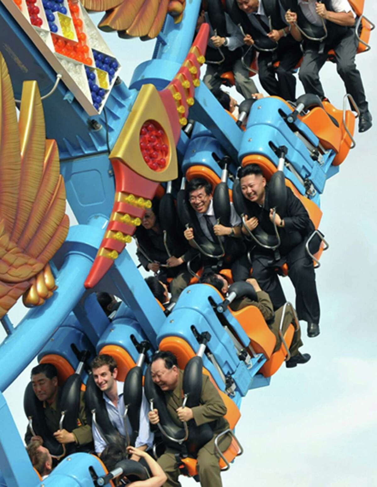 FILE - In this Wednesday, July 25, 2012 file photo released by the Korean Central News Agency and distributed in Tokyo by the Korea News Service Friday, July 27, 2012, North Korean leader Kim Jong Un, right in the middle, reacts as he takes a ride of an amusement attraction with Barnaby Jones, the first secretary and charges d?'affaires at the British Embassy, second from left in bottom, during the completion ceremony of the Rungna People's Pleasure Ground in Pyongyang, North Korea. Foreign diplomats and officials were among those invited to attend the ceremony. (AP Photo/Korean Central News Agency via Korea News Service, File) JAPAN OUT UNTIL 14 DAYS AFTER THE DAY OF TRANSMISSION