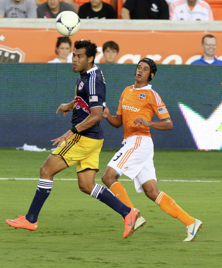 New York Red Bulls defender Wilman Conde (2) heads the ball against Houston Dynamo forward Calen Carr (3) during the first half of a MLS soccer game at BBVA Compass Stadium Friday, Aug. 3, 2012, in Houston, TX. ( J. Patric Schneider / For the Chronicle ) Photo: J. Patric Schneider, Houston Chronicle / © 2012 Houston Chronicle