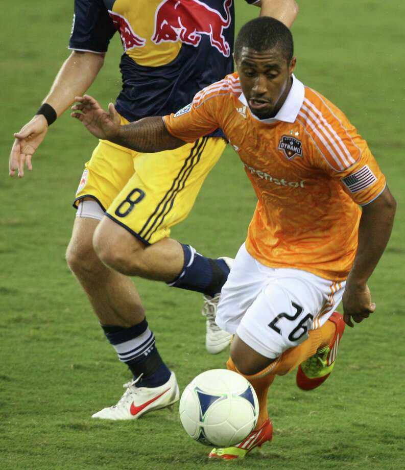 Houston Dynamo defender Corey Ashe (26) controls the ball during the first half of a MLS soccer game at BBVA Compass Stadium Friday, Aug. 3, 2012, in Houston, TX. ( J. Patric Schneider / For the Chronicle ) Photo: J. Patric Schneider, Houston Chronicle / © 2012 Houston Chronicle