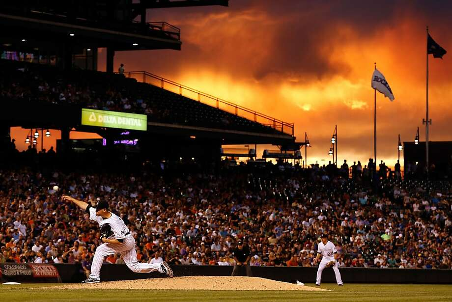 Pitcher Adam Ottavino #37 of the Colorado Rockies delivers against the San Francisco Giants as sunset falls over the stadium at Coors Field on August 3, 2012 in Denver, Colorado.  (Photo by Doug Pensinger/Getty Images) Photo: Doug Pensinger, Getty Images