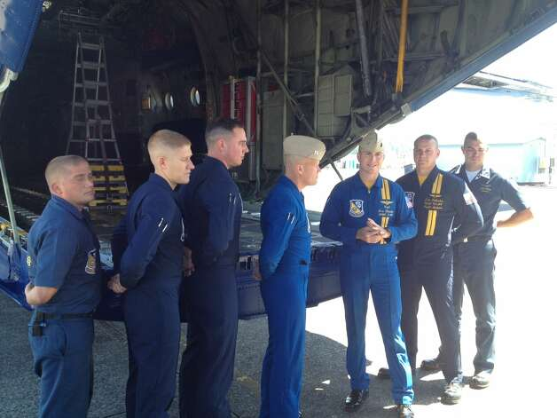 The crew of Fat Albert do their pre-flight briefing before the Blue Angels demonstration for Seafair on Friday, Aug. 3, 2012, in Seattle. (Nick Eaton / seattlepi.com)