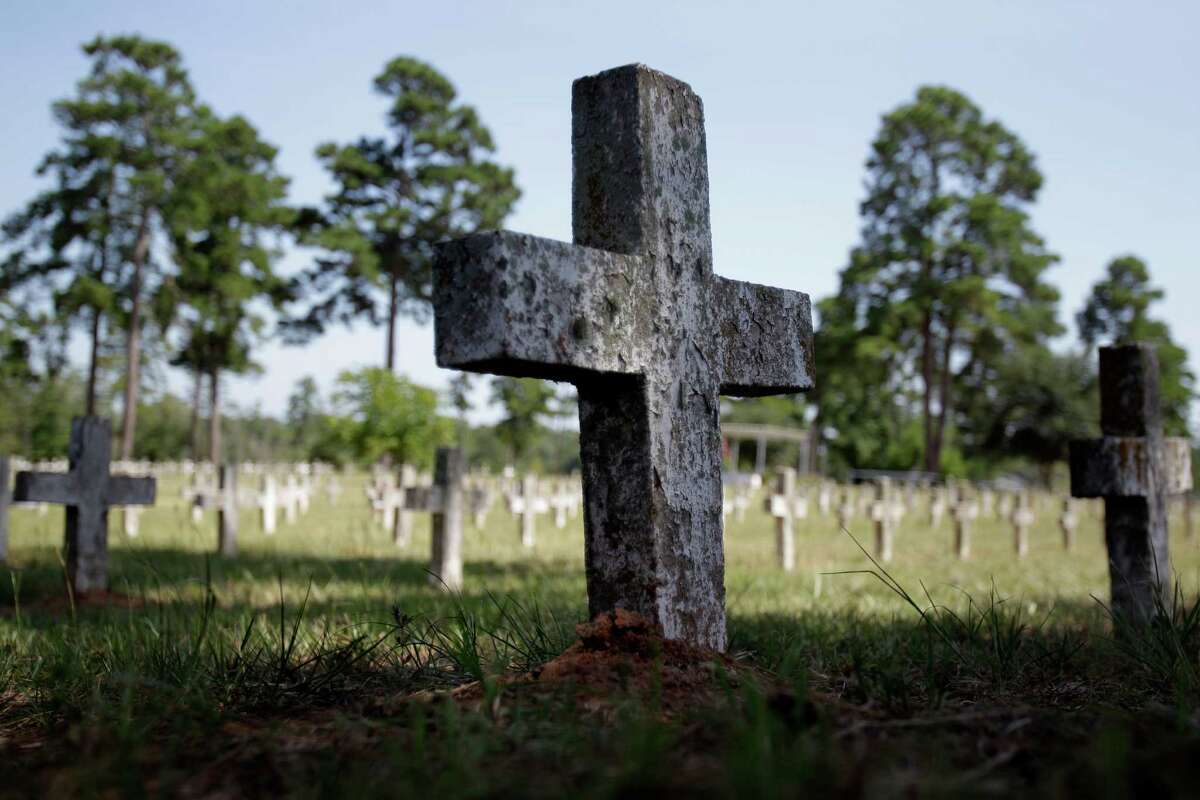 An unmarked cross stands amid graves of other inmates near the state prison in Huntsville. The cemetery, known by many as Peckerwood Hill, has been the last stop for indigent prisoners in Texas since the 1850s.