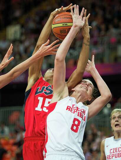 USA's Candace Parker takes a rebound away from Czech Republic's Ilona Burgrova during a women's prel