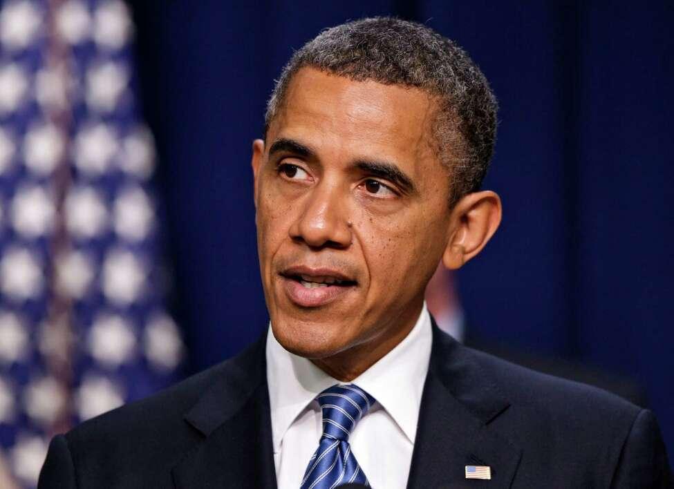 President Barack Obama talks abut taxes, Friday, August 3, 2012, in Eisenhower Executive Office Building on the White House campus in Washington. (AP Photo/J. Scott Applewhite)