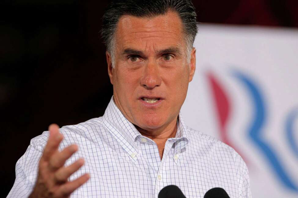 Republican presidential candidate, former Massachusetts Gov. Mitt Romney speaks to reporters after he campaigned at McCandless Trucking in North Las Vegas, Nev., Friday, Aug. 3, 2012. (AP Photo/Charles Dharapak)