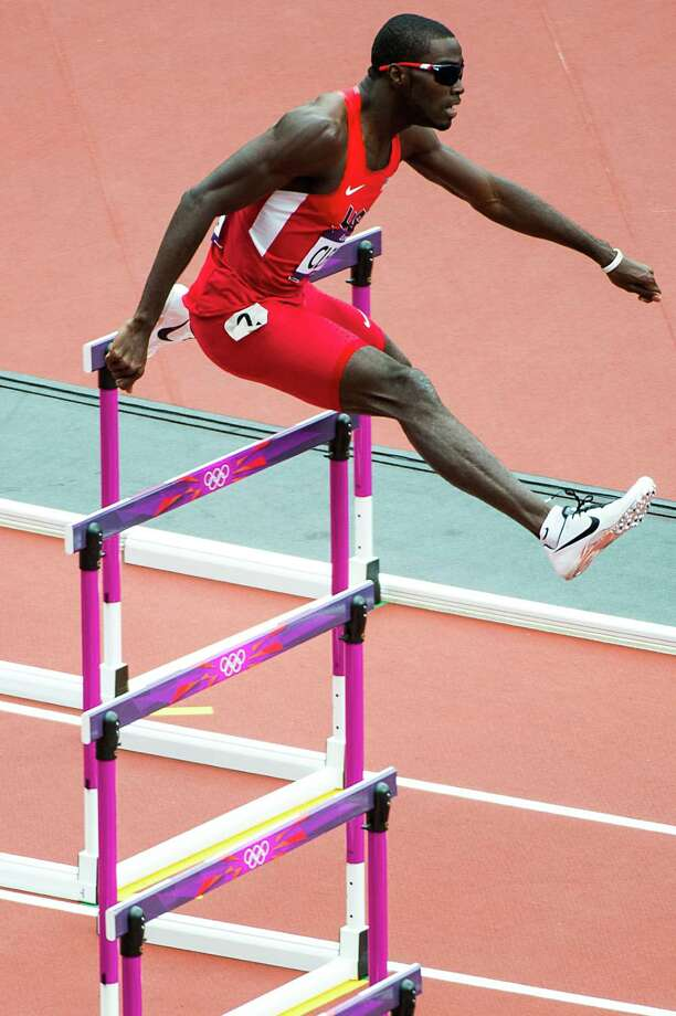 With gold on his mind, La Porte's Kerron Clement clears first-round heat in 400-meter hurdles Friday. Photo: Smiley N. Pool / © 2012  Houston Chronicle