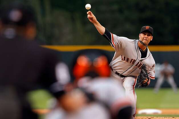 Starting pitcher Ryan Vogelsong #32 of the San Francisco Giants delivers against the Colorado Rockies at Coors Field on August 3, 2012 in Denver, Colorado.  (Photo by Doug Pensinger/Getty Images) Photo: Doug Pensinger, Getty Images / SF