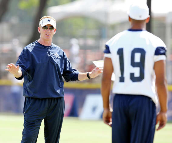 Dallas Cowboys head coach Jason Garrett (left) talks with wide receiver Miles Austin during 2012 training camp held Friday Aug 3, 2012 in Oxnard, CA. Photo: Edward A. Ornelas, Express-News / © 2012 San Antonio Express-News