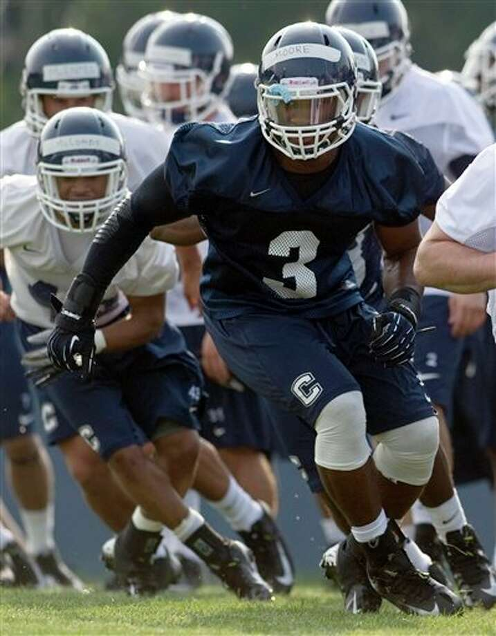 Connecticut linebacker Sio Moore (3) runs a drill the first NCAA fall football practice in Storrs, Conn., Friday, Aug. 3, 2012. (AP Photo/Jessica Hill)