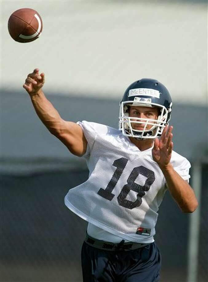 Connecticut quarterback Johnny McEntee throws during NCAA college football practice in Storrs, Conn., Friday, Aug. 3, 2012. Connecticut's quarterback job is apparently sophomore transfer Chandler Whitmer's to lose as the Huskies begin fall practice on Friday. McEntee will be in a group of four others trying to win the job away from Whitmer. (AP Photo/Jessica Hill)
