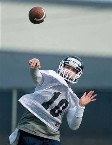 Connecticut quarterback Chandler Whitmer throws during the first NCAA fall football practice in Storrs, Conn., Friday, Aug. 3, 2012. Connecticut's quarterback job is apparently sophomore transfer Chandler Whitmer's to lose as the Huskies begin fall practice on Friday. Last year's starter, senior Johnny McEntee will be in a group of four others trying to win the job away from Whitmer. (AP Photo/Jessica Hill)