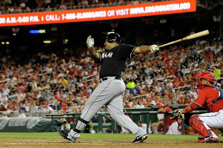 Former Astro Carlos Lee connects on a two-run single for the Marlins. Photo: Patrick McDermott, Getty Images / 2012 Getty Images