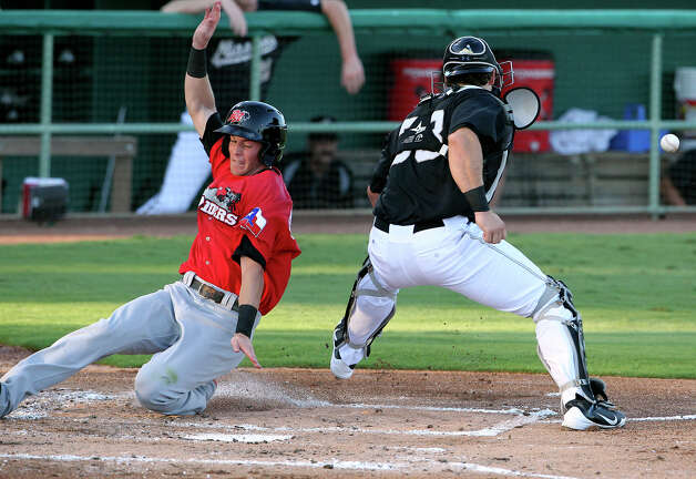 Frisco baserunner Ryan Strausborger scores the first run as Missions catcher Jason Hagerty drops the ball on a throw from first as the Missions host the Frisco Roughriders at Wolff Stadium on August 3, 2012. Photo: Tom Reel, Express-News / ©2012 San Antono Express-News