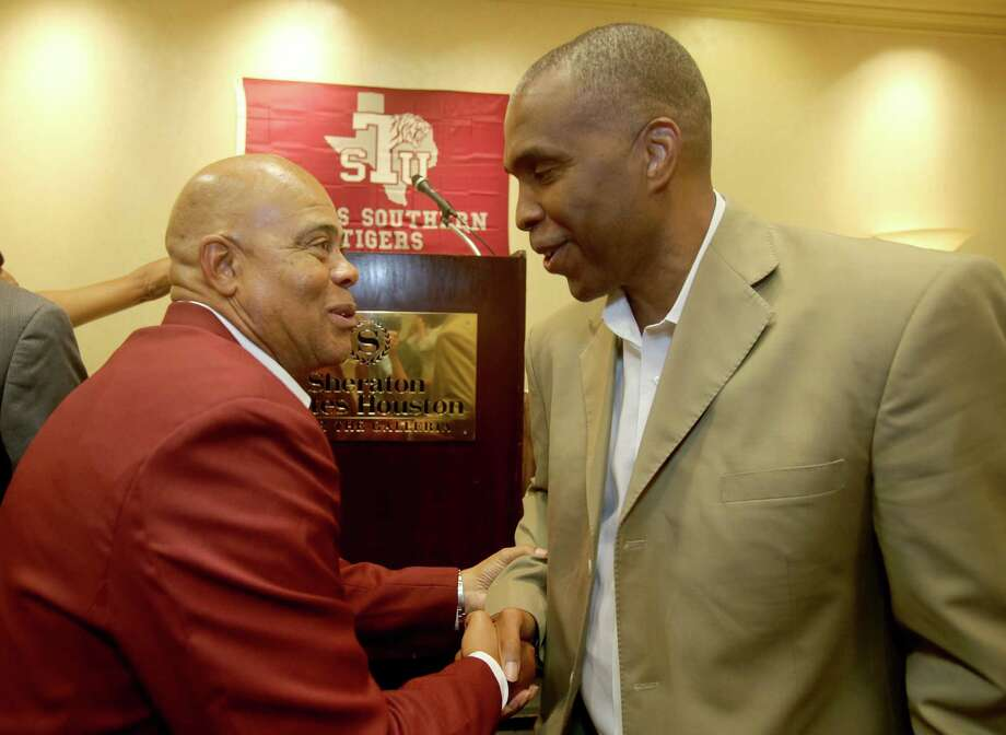TSU track coach Clyde Duncan, left, welcomes new interim basketball coach Mike Davis to the fold. Photo: Thomas B. Shea /  © 2012 Thomas B. Shea