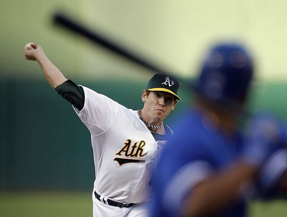 Oakland Athletics' Dan Straily pitches to Toronto Blue Jays' Edwin Encarnacion in the first inning of a baseball game Friday, Aug. 3, 2012, in Oakland, Calif. (AP Photo/Ben Margot) Photo: Ben Margot, Associated Press