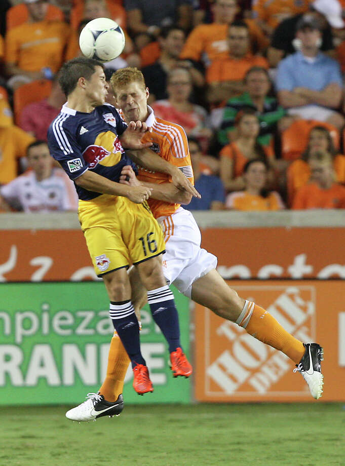 Houston Dynamo defender Andre Hainault (31) collides with New York Red Bulls midfielder Connor Lade (16) during the second half of a MLS soccer game at BBVA Compass Stadium Friday, Aug. 3, 2012, in Houston, TX. ( J. Patric Schneider / For the Chronicle ) Photo: J. Patric Schneider, Houston Chronicle / © 2012 Houston Chronicle