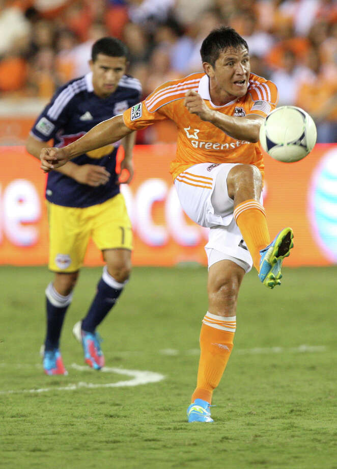 Houston Dynamo forward Brian Ching (25) passes the ball during a MLS soccer game against the New York Red Bulls at BBVA Compass Stadium Friday, Aug. 3, 2012, in Houston, TX. ( J. Patric Schneider / For the Chronicle ) Photo: J. Patric Schneider, Houston Chronicle / © 2012 Houston Chronicle