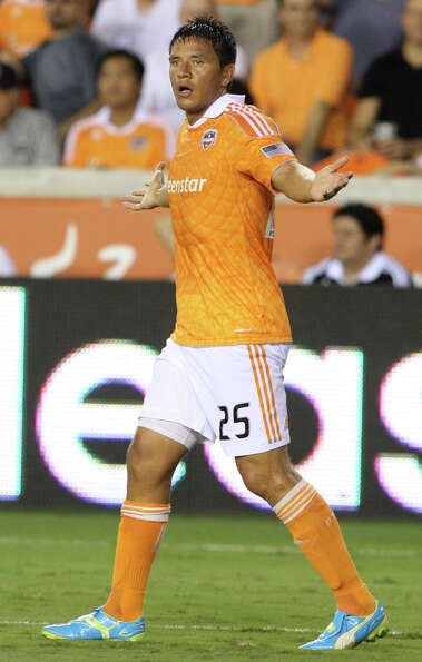 Houston Dynamo forward Brian Ching (25) reacts to a call during a MLS soccer game against the New Yo