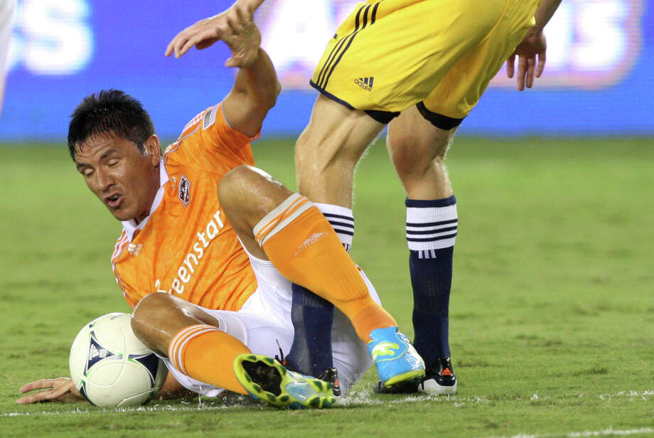 Houston Dynamo forward Brian Ching (25) trips during a MLS soccer game against the New York Red Bulls at BBVA Compass Stadium Friday, Aug. 3, 2012, in Houston, TX. ( J. Patric Schneider / For the Chronicle ) Photo: J. Patric Schneider, Houston Chronicle / © 2012 Houston Chronicle