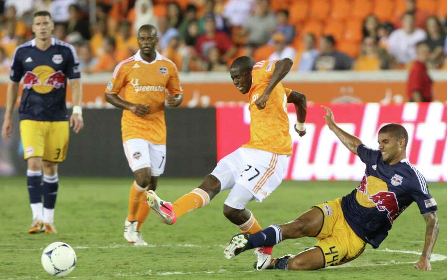 Houston Dynamo midfielder Boniek Garcia (27) dribbles past New York Red Bulls midfielder Victor Palsson (44) during the second half of a MLS soccer game at BBVA Compass Stadium Friday, Aug. 3, 2012, in Houston, TX. ( J. Patric Schneider / For the Chronicle ) Photo: J. Patric Schneider, Houston Chronicle / © 2012 Houston Chronicle