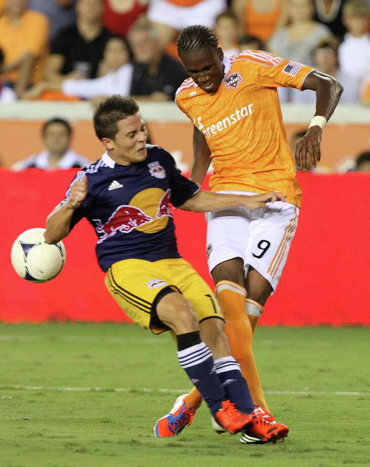 Houston Dynamo forward Macoumba Kandji (9) battles with New York Red Bulls midfielder Connor Lade (16) during a MLS soccer game at BBVA Compass Stadium Friday, Aug. 3, 2012, in Houston, TX. ( J. Patric Schneider / For the Chronicle ) Photo: J. Patric Schneider, Houston Chronicle / © 2012 Houston Chronicle