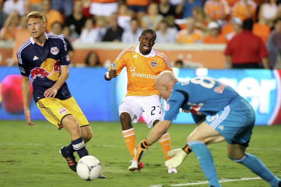Houston Dynamo midfielder Boniek Garcia (27) takes a shot against New York Red Bulls goalkeeper Bill Gaudette (88) during the second half of a MLS soccer game at BBVA Compass Stadium Friday, Aug. 3, 2012, in Houston, TX. ( J. Patric Schneider / For the Chronicle ) Photo: J. Patric Schneider, Houston Chronicle / © 2012 Houston Chronicle