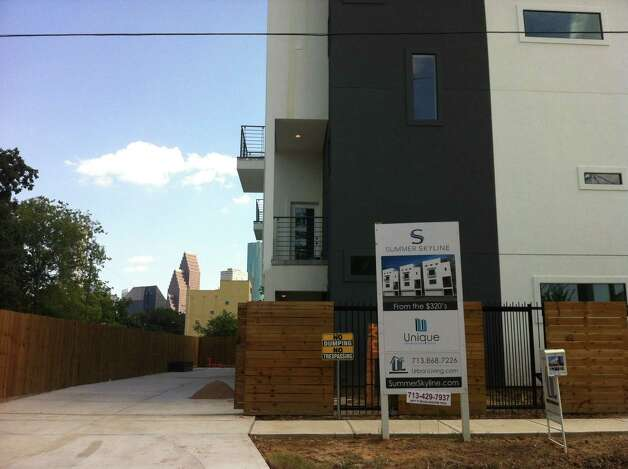 Summer Skyline townhomes are one face of new construction being seen in Houston's First Ward. The area, known for its collection of artist residents and studios, is attracting empty-nesters and young professionals. Photo: Nancy Sarnoff