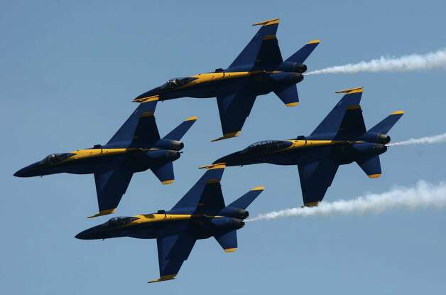 The Blue Angels perform over Lake Washington on Friday, August 3, 2012 during Seafair 2012. (Joshua Trujillo, seattlepi.com) Photo: Ted S. Warren / Associated Press