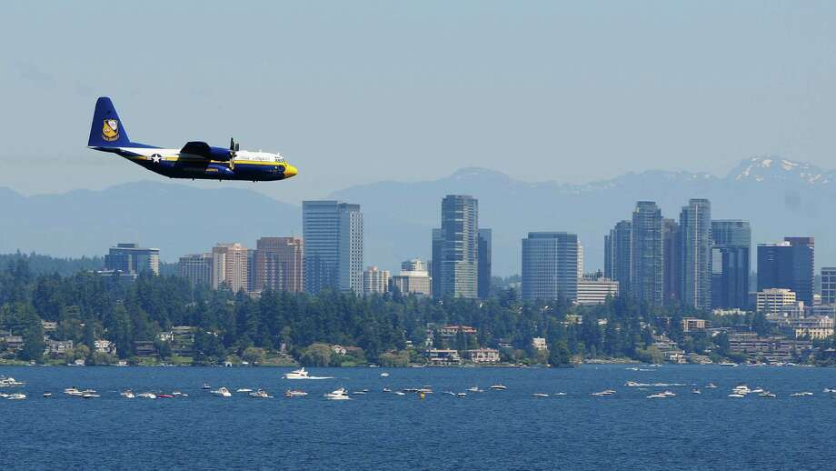 Fat Albert, a  C-130 aircraft, flies past the Bellevue skyline. Photo: LINDSEY WASSON / SEATTLEPI.COM