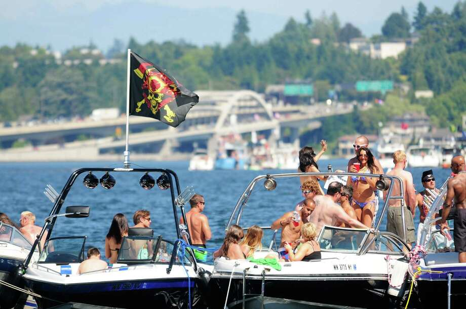 Many people enjoy the sun and clear blue skies on powerboats during Seafair. Photo: LINDSEY WASSON  / SEATTLEPI.COM