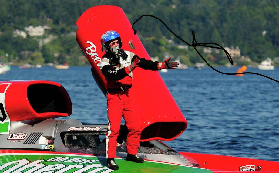 Driver Steve David of Oh Boy! Oberto catches a line from his pit crew after a qualifying heat of  149.756 for the Albert Lee Cup at Seafair. Photo: LINDSEY WASSON  / SEATTLEPI.COM