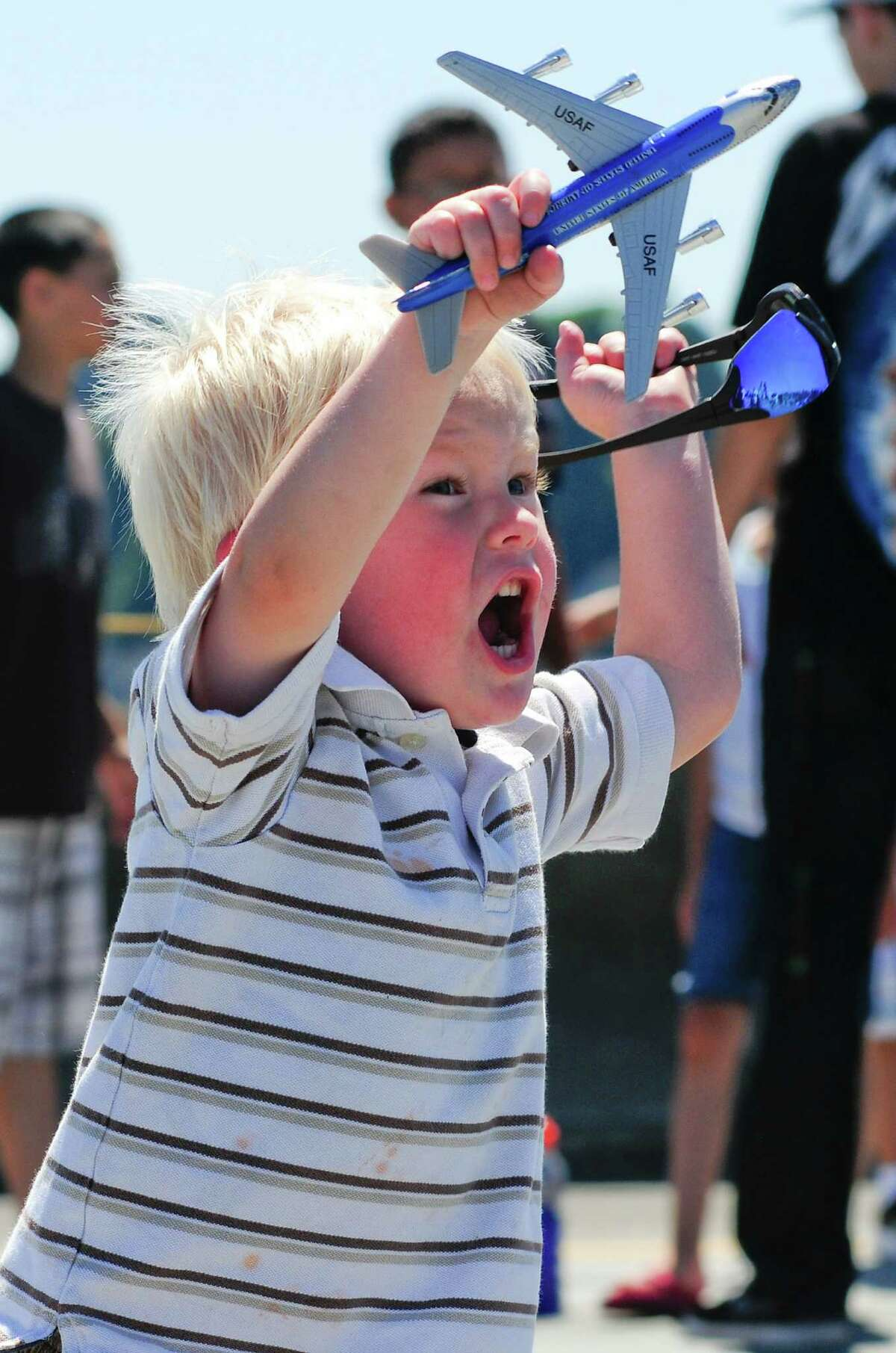 Gavin Ellis, 2, gets enthusiastic about his model plane while watching a Blue Angels demonstration over Lake Washington on a sunny Friday, August 3, 2012. The team will perform again on Saturday and Sunday as part of Seattle's annual Seafair activities.