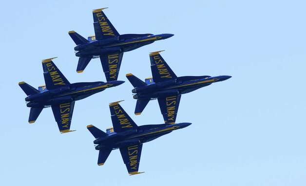 The U.S. Navy Blue Angels fly in formation during a demonstration over Lake Washington on a sunny Friday, August 3, 2012. The team will perform again on Saturday and Sunday as part of Seattle's annual Seafair activities. Photo: LINDSEY WASSON / SEATTLEPI.COM