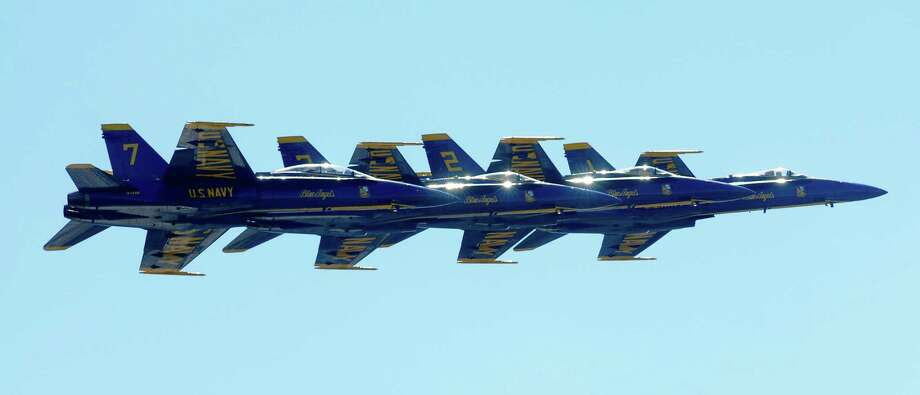 Navy Blue Angels fly in a tight formation line during a demonstration over Lake Washington. Photo: LINDSEY WASSON / SEATTLEPI.COM