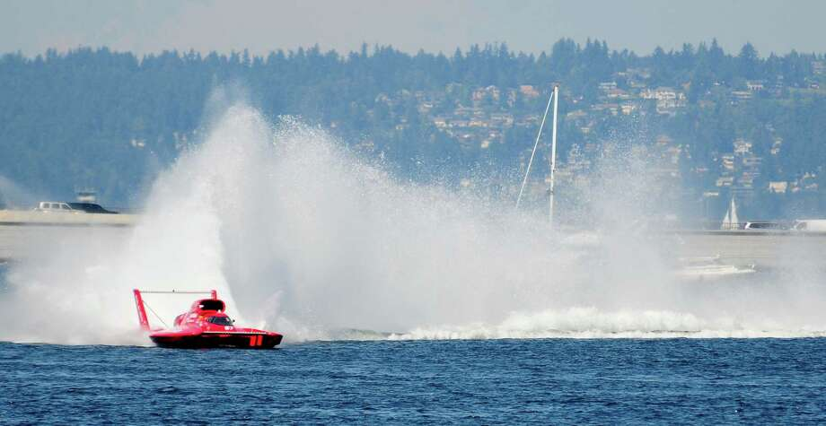 N. Mark Evans in the U-57 Miss DiJulio kicks up some spray during a turn in a qualifying heat for the Albert Lee Cup at Seafair. Photo: LINDSEY WASSON  / SEATTLEPI.COM