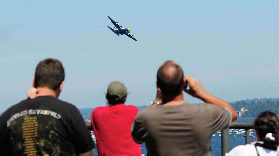 The Blue Angels' cargo aircraft, the  C-130 Fat Albert, flies over Lake Washington. Photo: LINDSEY WASSON / SEATTLEPI.COM