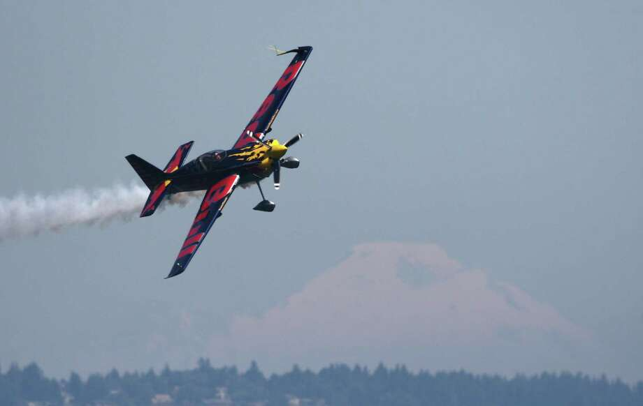 The Red Bull Air Force Demonstration team performs over Lake Washington with Mount Baker as a backdrop. Photo: JOSHUA TRUJILLO / SEATTLEPI.COM